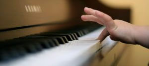 cropped child finger piano